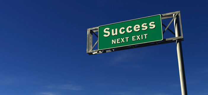 Highway sign saying Success Next Exit